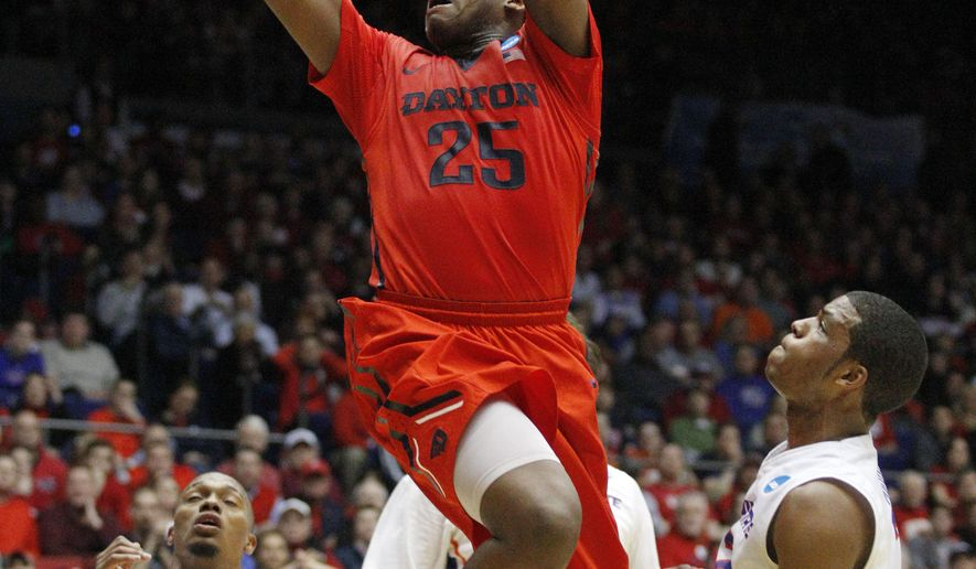 FILE- In this March 18, 2015, file photo, Dayton's Kendall Pollard (25) shoots against Boise State in the first half of a first round NCAA tournament basketball game in Dayton, Ohio. The NCAA announced Monday, July 20, 2015, that the Division I selection committee will now be allowed to slide every team up or down the seed list, including the last four at-large teams selected. Last season, the seeding process placed Dayton into the First Four, playing at home. (AP Photo/Skip Peterson, File)