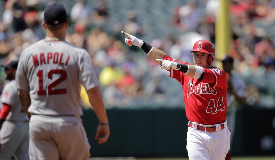Los Angeles Angels' Daniel Robertson, right, celebrates his RBI double in front of Boston Red Sox first baseman Mike Napoli during the second inning of a baseball game, Monday, July 20, 2015, in Anaheim, Calif. (AP Photo/Jae C. Hong)