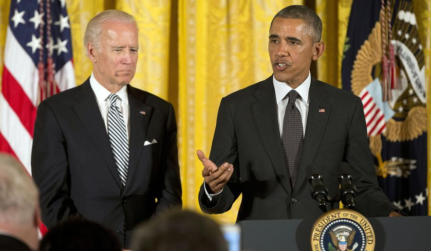 President Barack Obama with Vice President Joe Biden, speaks at a reception in the East Room of the White House in Washington, Monday, July 20, 2015. Obama spoke regarding the 25th anniversary of the Americans with Disabilities Act. (AP Photo/Pablo Martinez Monsivais)