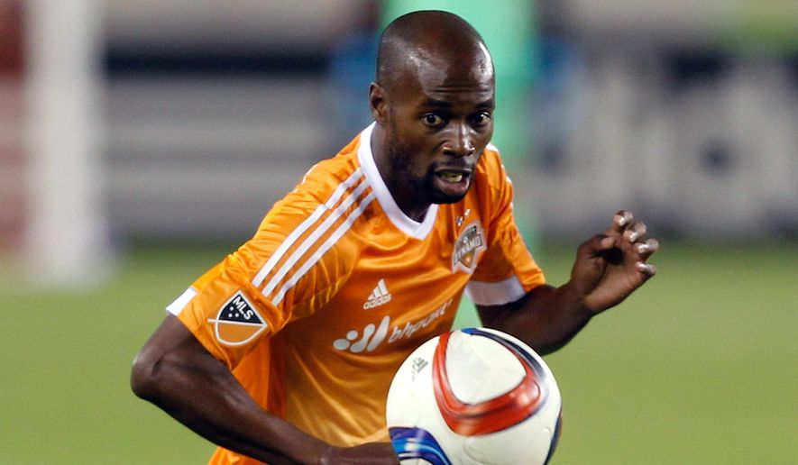 FILE - In this March 7, 2015, file photo, Houston Dynamo defender DaMarcus Beasley controls the ball during an MLS soccer match in Houston. Beasley was content with his December decision to retire from the U.S. national team. wanting to spend time with his now 16-month-old daughter. But when coach Jurgen Klinsmann asked him to return for the CONCACAF Gold Cup, the 33-year-old defender could not say no.  (AP Photo/Bob Levey, File)