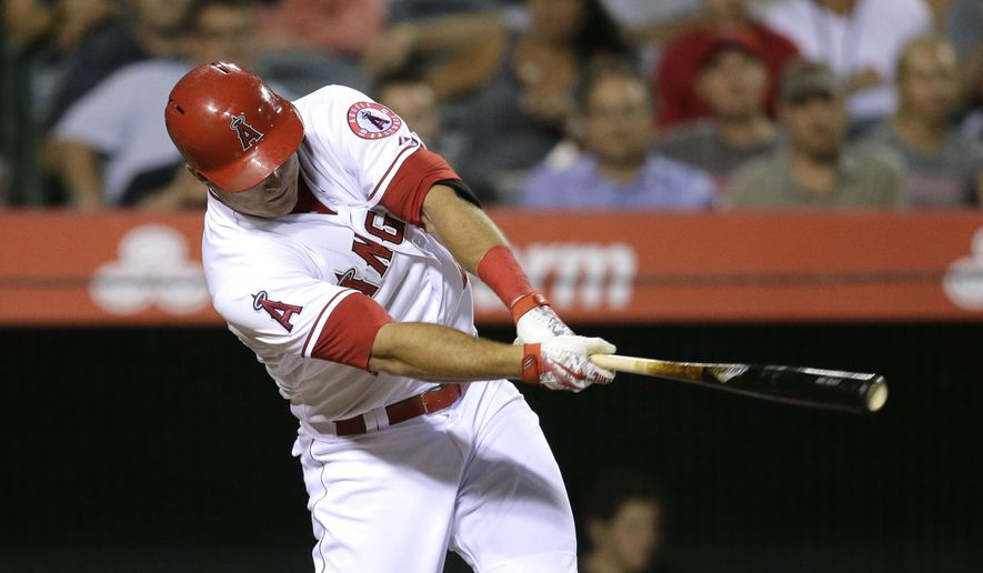 Los Angeles Angels' Mike Trout hits a home run against the Boston Red Sox in the fifth inning of the second baseball game in a doubleheader, Monday, July 20, 2015, in Anaheim, Calif. (AP Photo/Jae C. Hong)