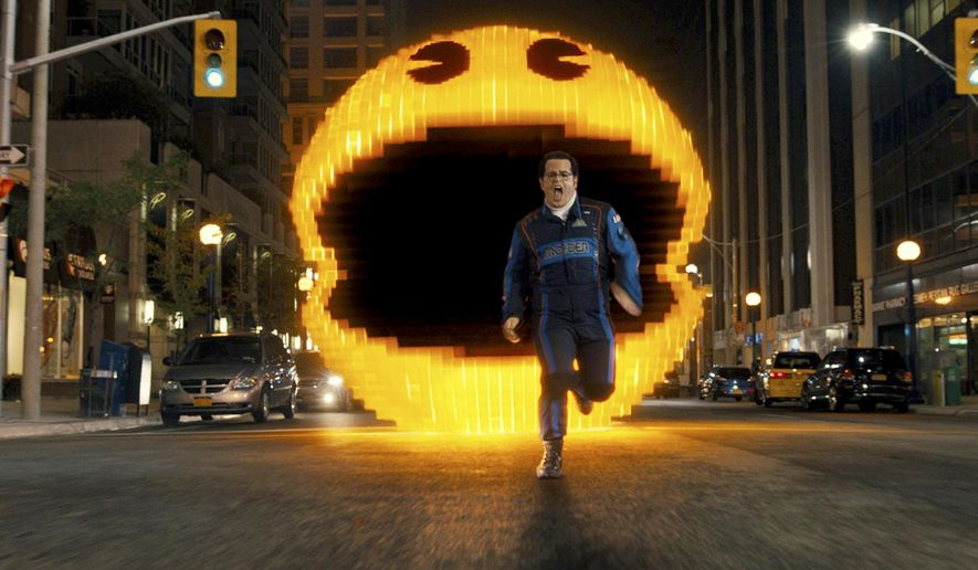 "This photo provided by courtesy of Sony Pictures shows Josh Gad as Ludlow chased by Pac-Man in Columbia Pictures' ""Pixels."" The movie releases in the U.S. on July 24, 2015. (Sony Pictures via AP) ** FILE **"