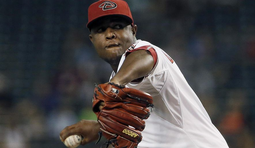 Arizona Diamondbacks' Rubby De La Rosa throws a pitch against the Miami Marlins during the first inning of a baseball game Monday, July 20, 2015, in Phoenix. (AP Photo/Ross D. Franklin)