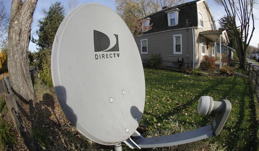This Nov. 2, 2011, file photo shows a DirecTV satellite dish on a post in the front yard of a home in Harmony, Pa. On Tuesday, July 21, 2015, the head of the Federal Communications Commission recommended approving AT&T's $48.5 billion purchase of DirecTV. The deal would create the country's largest provider of cable or satellite TV. (AP Photo/Keith Srakocic, File)