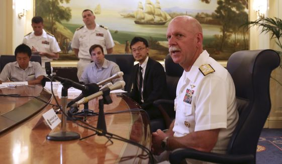 "Adm. Scott Swift, right, the new commander of the U.S. Pacific Fleet, speaks during a press conference in Tokyo Tuesday, July 21, 2015 during the last stop of a three-country Asian tour. The commander sounded a conciliatory note toward China. ""We have much more in common than we do in competition,"" Swift told reporters. He added, though, that the Navy is ready to respond to any situation that might arise, if called upon by the American president. (AP Photo/Ken Moritsugu)"