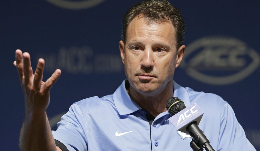 North Carolina coach Larry Fedora responds to questions during the ACC NCAA college football kickoff in Pinehurst, N.C., Tuesday, July 21, 2015. (AP Photo/Gerry Broome)
