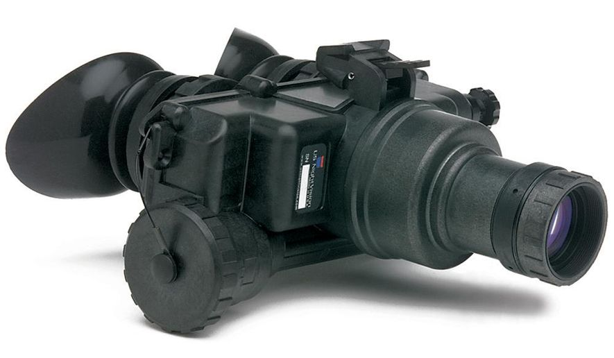 This undated photo, provided by US Night Vision Corp., shows night vision goggles. A man who lives in China was arrested in Hawaii for allegedly arranging to buy six pairs of military-grade night vision goggles from an undercover federal agent and trying to export them to his home country, court documents show. (US Night Vision Corp. via AP)