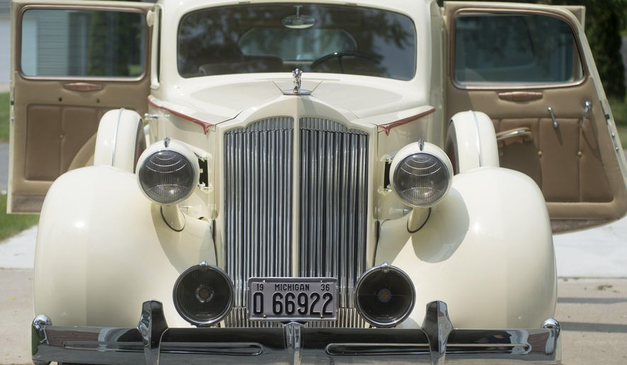 This July 6, 2015 photo shows the restored 1936 Packard Eight Club Sedan owned by John Town of Moonlight Upholstery in Carrollton Township, Mich. There were only 4,004 of these made that year according to Town. (Jeff Schrier/The Saginaw News via AP)