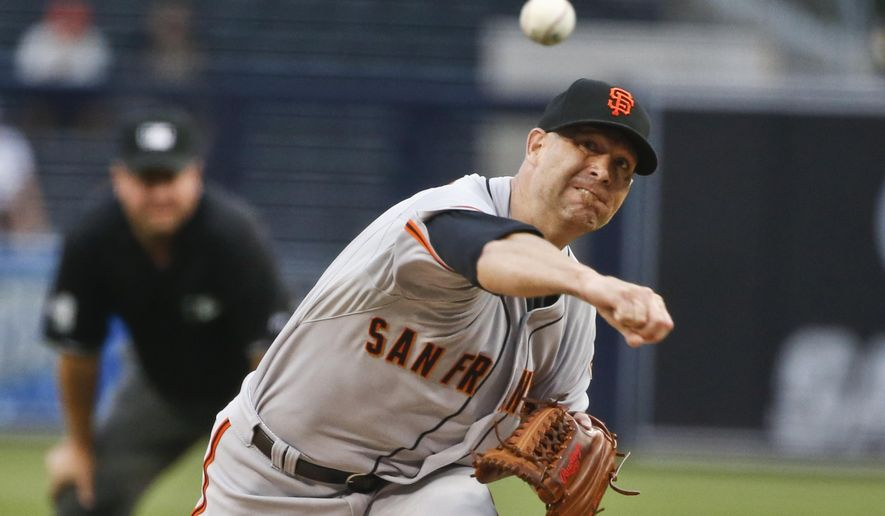 San Francisco Giants starting pitcher Tim Hudson throws against the San Diego Padres in the first inning of a baseball game Monday, July 20, 2015, in San Diego. (AP Photo/Lenny Ignelzi)