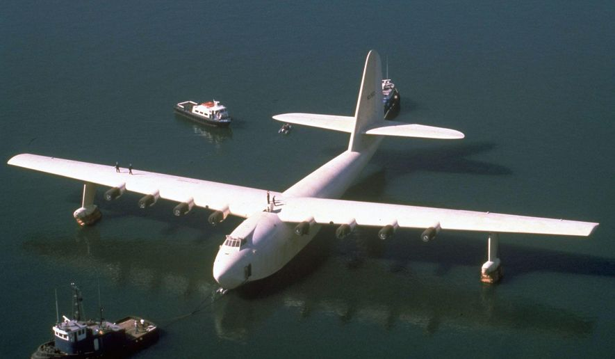 """FILE - In this Oct. 29, 1980 file photo, Howard Hughes' wooden flying boat the """"Spruce Goose,"""" is towed by a tugboat from its hangar in Long Beach, Calif. The gigantic historic wooden airplane whose fate was mired in a financial dispute, will permanently stay in Oregon. The Evergreen Aviation and Space Museum has reached an agreement with the Aero Club of Southern California to take full ownership of the plane in the coming weeks, said California attorney Robert E. Lyon, who represents the Aero Club. Lyon said the agreement was reached in early July 2015. (AP Photo, File)"""