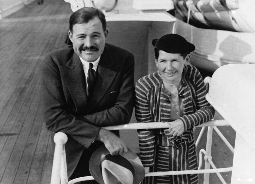 """In this April 3, 1934, file photo, author Ernest Hemingway and his wife Pauline Pfeiffer arrive in New York aboard the liner """"Paris,"""" after a three-month vacation in eastern Africa hunting lions. (AP Photo, File)"""