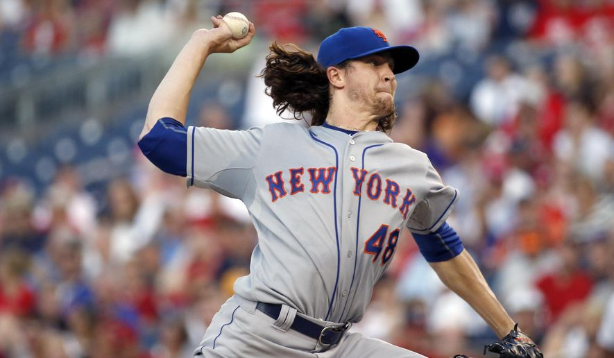 New York Mets starting pitcher Jacob deGrom throws during the third inning of a baseball game against the Washington Nationals at Nationals Park, Tuesday, July 21, 2015, in Washington. (AP Photo/Alex Brandon)