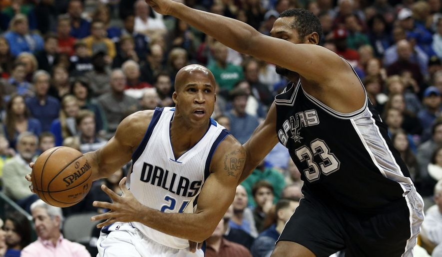 FILE - In this Saturday, Dec. 20, 2014 file photo, Dallas Mavericks forward Richard Jefferson (24) drives the ball around San Antonio Spurs forward Boris Diaw (33) during the first half of an NBA basketball game in Dallas. Jefferson has agreed to terms on a one-year deal for next season with Cleveland, a person familiar with the negotiations told The Associated Press on Tuesday, July 21, 2015.  The person spoke on condition of anonymity because Jefferson has not yet signed his contract. (AP Photo/Jim Cowsert, File)