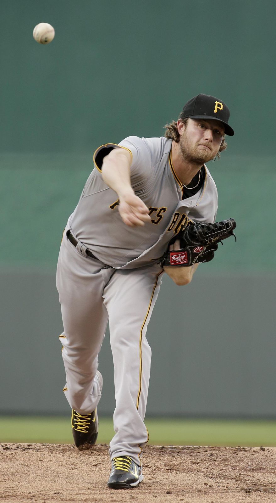 Pittsburgh Pirates starting pitcher Gerrit Cole throws during the first inning of a baseball game against the Kansas City Royals Tuesday, July 21, 2015, in Kansas City, Mo. (AP Photo/Charlie Riedel)