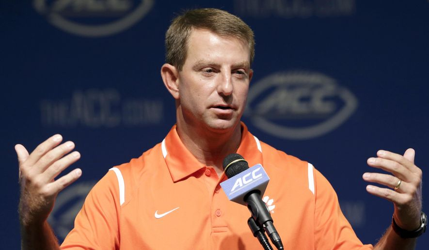 Clemson coach Dabo Swinney responds to questions during the ACC NCAA college football kickoff in Pinehurst, N.C., Tuesday, July 21, 2015. (AP Photo/Gerry Broome)