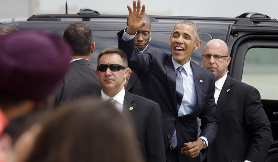 "President Obama waves to supporters as he leaves John. F. Kennedy International Airport. He was in New York on Tuesday for a taping of ""The Daily Show"" and a private fundraiser. (AP Photo)"