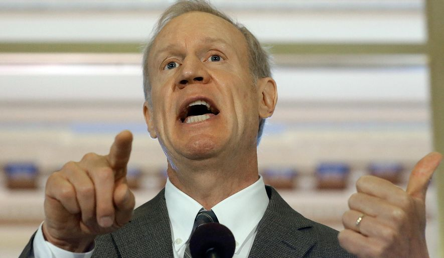 Illinois Gov. Bruce Rauner speaks to members of the press outside his office at the Illinois State Capitol Tuesday, July 21, 2015, in Springfield Ill. Rauner has stepped up the pressure on House Speaker Michael Madigan over the lack of a budget deal. (AP Photo/Seth Perlman)