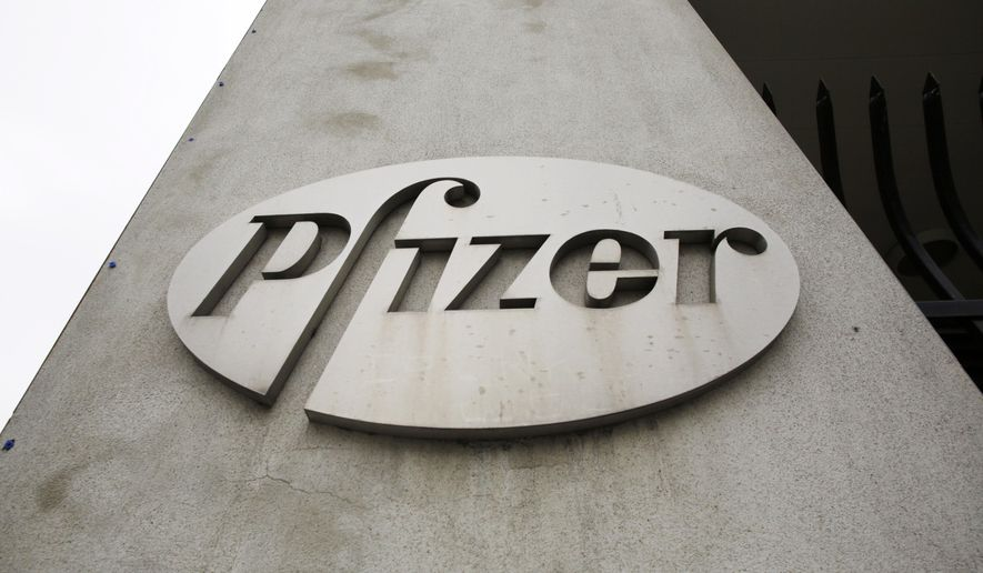 FILE - This May 4, 2014 file photo shows the logo on the exterior of a former Pfizer factory in the Brooklyn borough of New York. Pfizer has expanded its research on vaccines to eventually safeguard people from cradle to grave, from shots for pregnant women to protect their babies from the moment of birth to vaccines for senior citizens with waning immune systems, company officials said Tuesday, July 21, 2015. (AP Photo/Mark Lennihan, File)