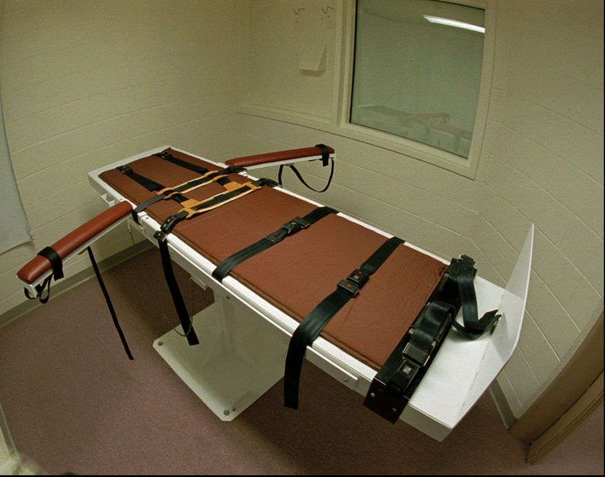 FILE - This Sept. 24, 1997 file photo shows the table on which the convicted murderer Gary Lee Davis was executed in the Colorado State Penitentiary east of Canon City, Colo. Just three people sit on death row in Colorado. Even if Aurora theater mass shooter James Holmes, who was convicted on July 16, 2015, is sentenced to death, he could spend much of the rest of his life in prison awaiting execution. (AP Photo/David Zalubowski, file)