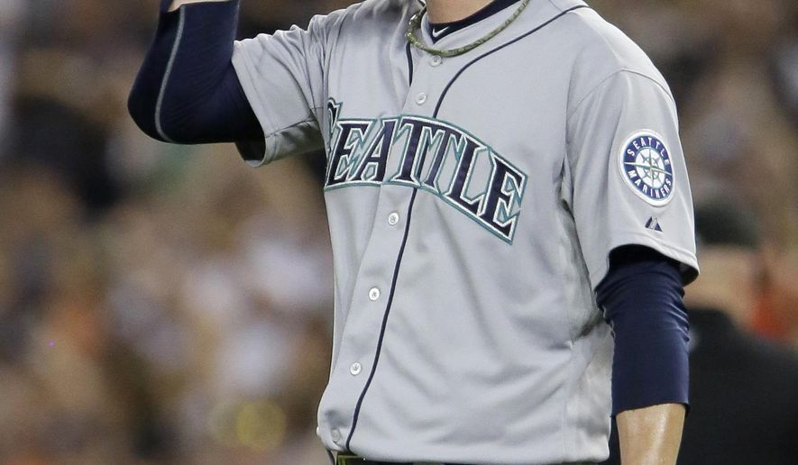 Seattle Mariners pitcher Mark Lowe reacts after giving up a two-run home run to Detroit Tigers' Ian Kinsler during the eighth inning of a baseball game Monday, July 20, 2015 in Detroit. The Tigers defeated the Mariners 5-4. (AP Photo/Duane Burleson)