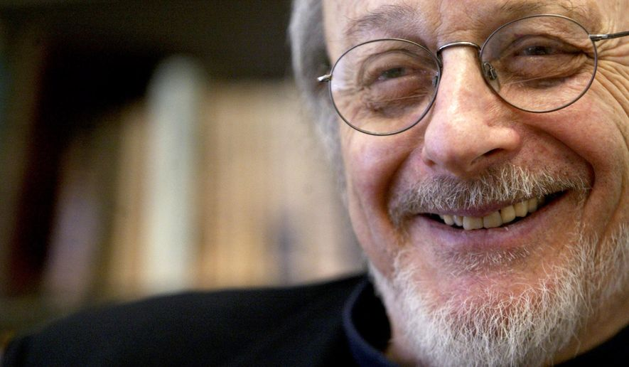 FILE - In this April 27, 2004, file photo, American author E.L. Doctorow smiles during an interview in his office at New York University in New York. According to Doctorow's son Richard, the author died Tuesday, July 21, 2015, in New York from complications of lung cancer. He was 84. (AP Photo/Mary Altaffer, File)