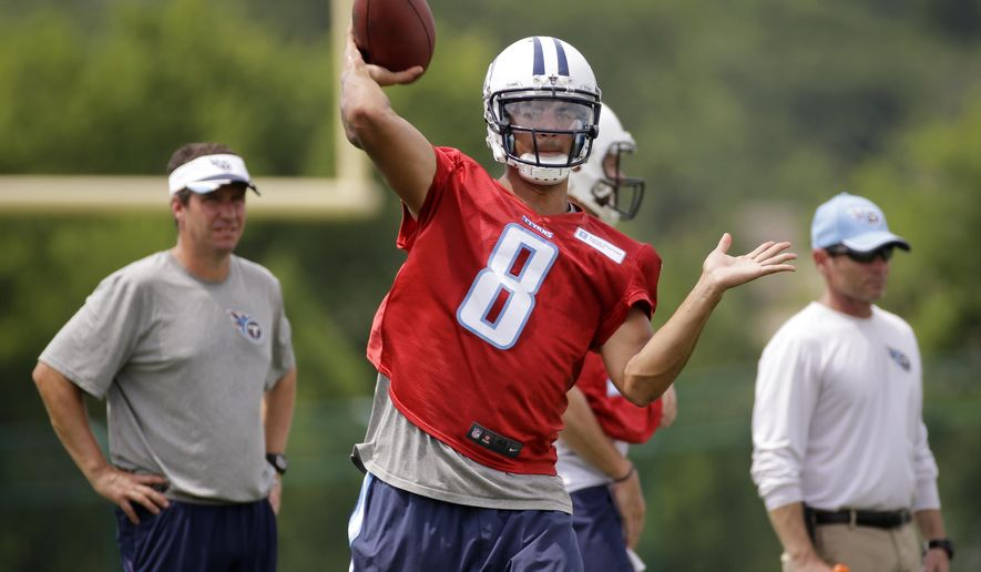 FILE - In this June 18, 2015, file photo, Tennessee Titans quarterback Marcus Mariota passes during the NFL football team's minicamp in Nashville, Tenn. Mariota signed with the Titans on Tuesday, July 21, becoming the last of the NFL's first-round draft picks to finalize his deal. The former Oregon quarterback is expected to start immediately, with the timing of the contract keeping the No. 2 overall pick on track to open the season Sept. 13 at Tampa Bay against Jameis Winston--the No. 1 overall selection from the draft. (AP Photo/Mark Humphrey, File)