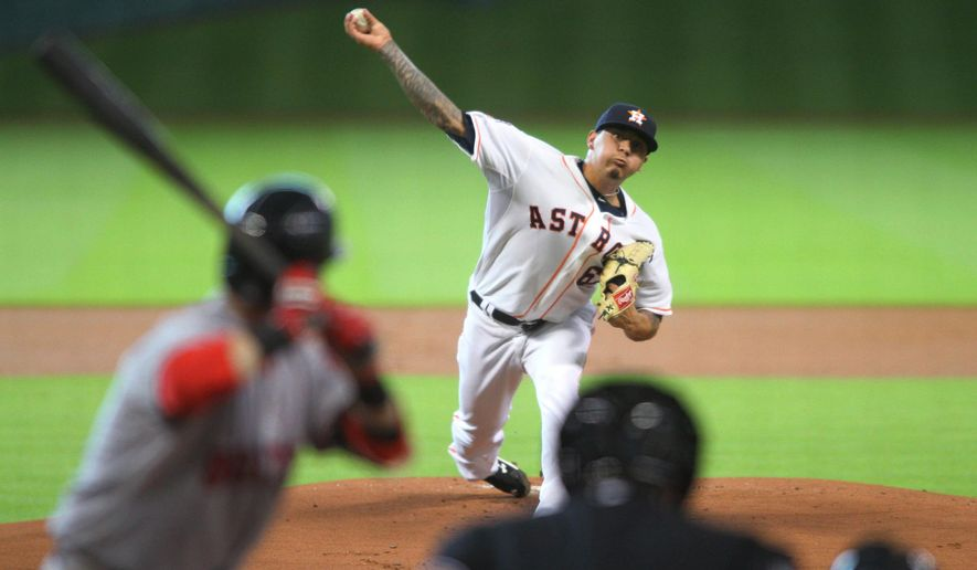 Houston Astros pitcher Vince Velasquez delivers a pitch to Boston Red Sox batter Dustin Pedrola during the first inning of a baseball game Tuesday, July 21, 2015, in Houston.  (AP Photo/Richard Carson)
