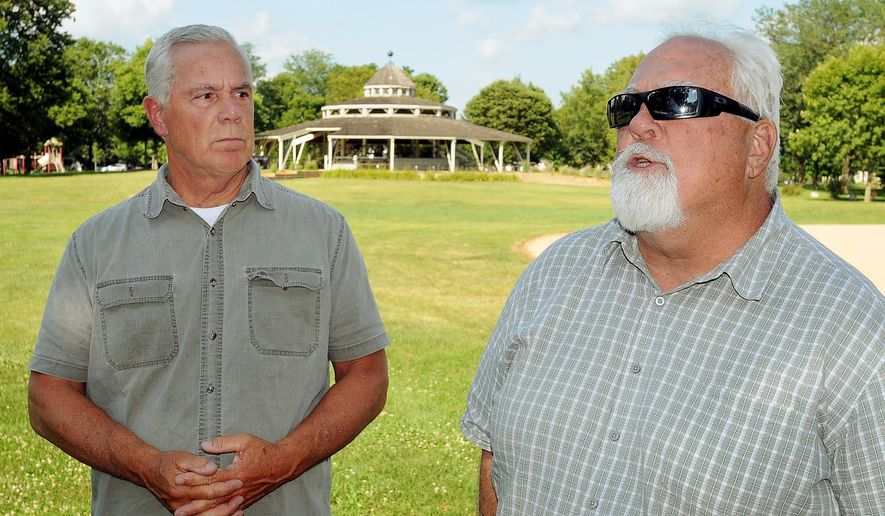 Rep. Jack Considine, D-Mankato, right, and Rep. Tony Cornish, R-Vernon Center, meet with the media in Minnesota Square Park in St. Peter, Minn. following a tour of the Minnesota Security Hospital on Tuesday, July 21, 2015. Legislators and state officials toured the facility following an assault on an employee by a 16-year-old patient earlier this month. (John Cross/The Mankato Free Press via AP) MANDATORY CREDIT