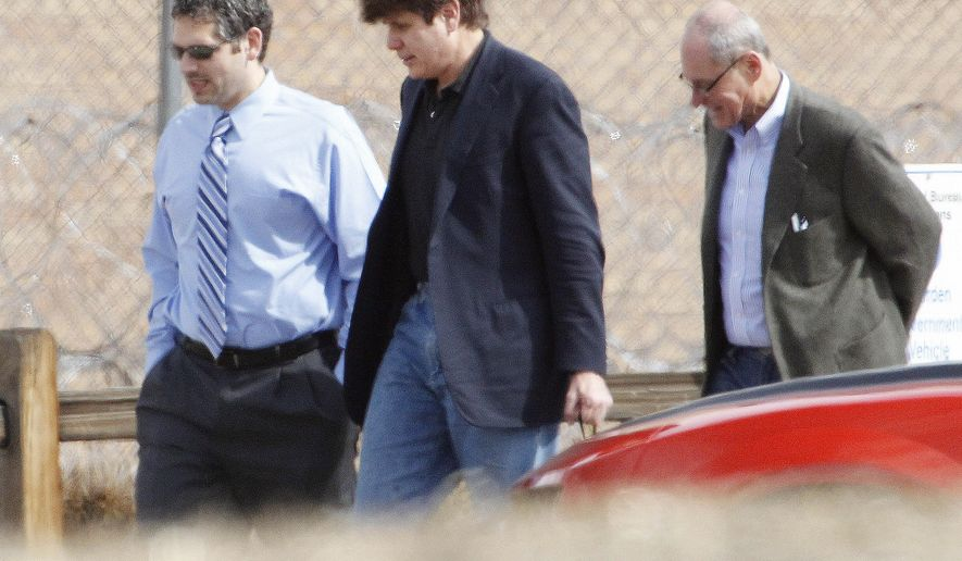 FILE - In this March 15, 2012 file photo Former Illinois Gov. Rod Blagojevich, center, walks with attorneys as he arrives at the Federal Correctional Institution Englewood in Littleton, Colo., to begin serving his 14-year sentence for corruption. The 7th U.S. Circuit Court of Appeals overturned some of the corruption convictions of the imprisoned former Governor in a ruling released Tuesday, July 21, 2015, saying prosecutors did not prove Blagojevich broke the law as he appeared to try to auction off an appointment to President Barack Obama's old Senate seat. (AP Photo/Ed Andrieski,File)