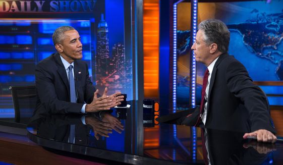 """President Barack Obama, left, talks with Jon Stewart, host of """"The Daily Show"""" during a taping, on Tuesday, July 21, 2015, in New York. (AP Photo/Evan Vucci)"""
