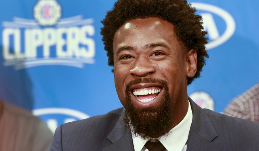 Los Angeles Clippers DeAndre Jordan, the league rebounding champion, is reintroduced by the team at a news conference at Staples Center in Los Angeles on Tuesday, July 21, 2015. The Clippers managed to keep Jordan after he changed his mind about his verbal commitment to Dallas. Jordan thought the Dallas Mavericks offered everything he wanted, including a fresh start and a bigger offensive role. When Jordan thought about it a little more, the craziest free-agent recruitment story in recent NBA history ended with him back on the Los Angeles Clippers. (AP Photo/Nick Ut)