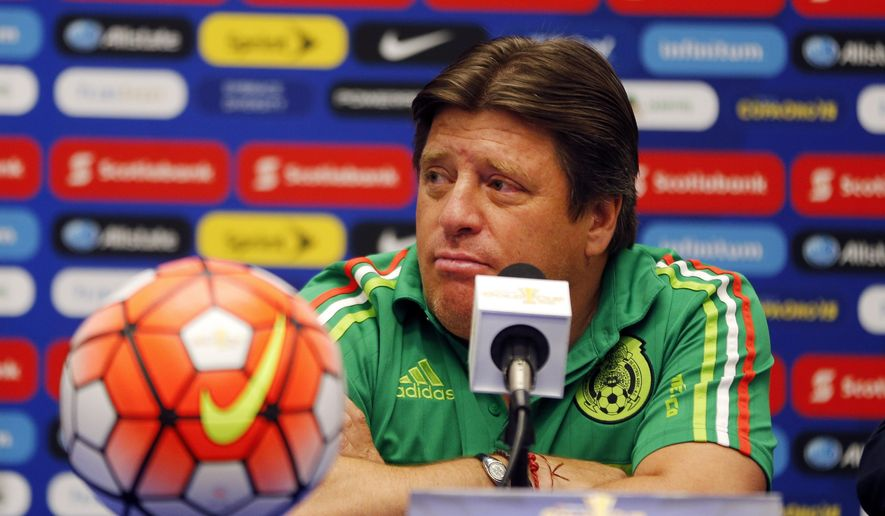 Mexico men's soccer coach Miguel Herrera speaks during a news conference Tuesday, July 21, 2015, in Atlanta. Mexico is scheduled to face Panama in a semifinal of the CONCACAF Gold Cup on Wednesday night in Atlanta. (AP Photo/John Bazemore)