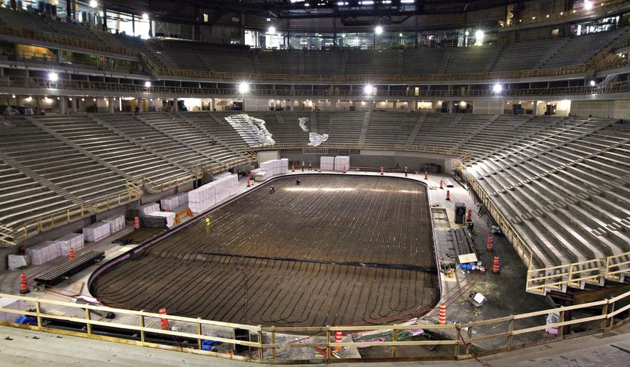 FILE - In this Sept. 26, 2014, file photo, work continues on the the Videotron Centre in Quebec City. The NHL is one step closer to establishing expansion teams in Las Vegas and Quebec City. The league announced Tuesday, July 21, 2015, it has received applications from prospective ownership groups in both markets, a day after a deadline for submissions. (Clement Allard/The Canadian Press via AP, File)