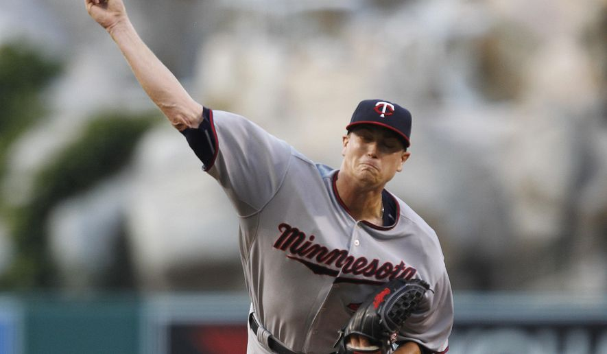 Minnesota Twins starting pitcher Kyle Gibson throws against the Los Angeles Angels during the first inning of a baseball game in Anaheim, Calif., Tuesday, July 21, 2015. (AP Photo/Alex Gallardo)