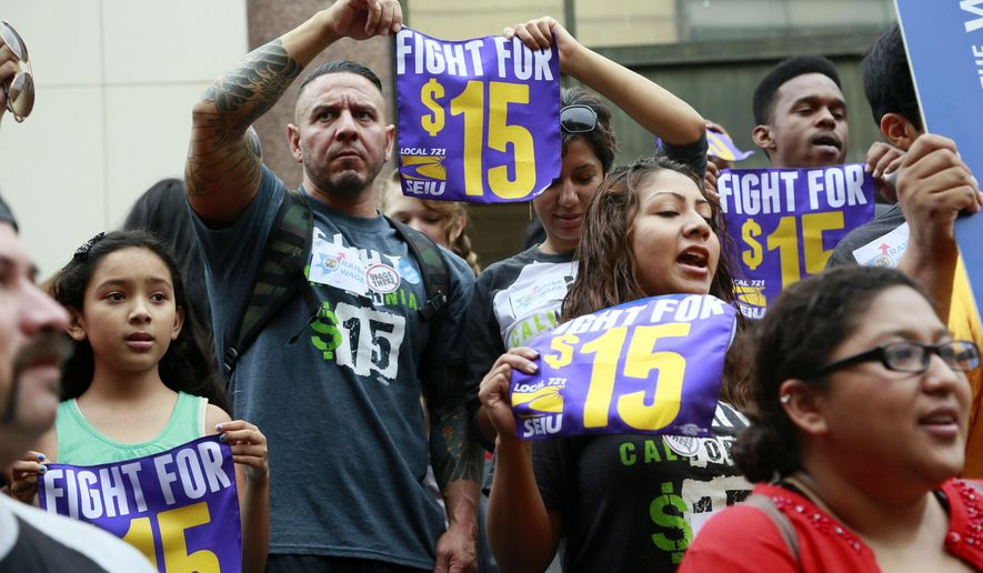 Workers hold a rally in support of the Los Angeles County Board of Supervisors' proposed minimum wage ordinance, in Los Angeles, on Tuesday, July 21, 2015. The nation's most populous county could lift the minimum wage for some workers to $15 an hour by 2020. The Los Angeles County Board of Supervisors is expected to take a preliminary step Tuesday, July 21, that could lead to the higher wages. (AP Photo/Nick Ut)
