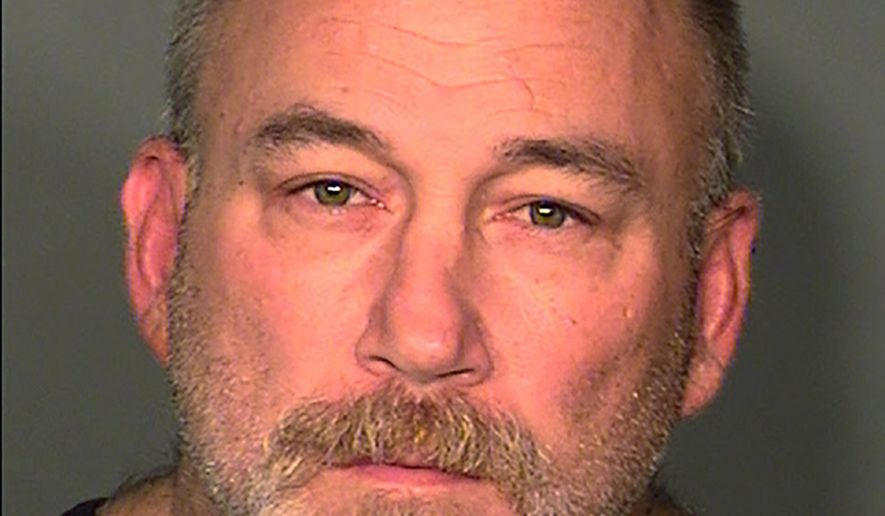 This booking photo provided by the Las Vegas Metropolitan Police Department shows Patrick Joel Stoltz, of Aurora, Colo. Police said Stoltz, who was shot and wounded by officers at a hotel early Saturday, July 18, 2015, wanted to be killed by officers based on letters he wrote. (Las Vegas Metropolitan Police Department via AP)
