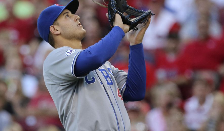 Chicago Cubs first baseman Anthony Rizzo catches a pop fly from Cincinnati Reds' Raisel Iglesias during the second inning of a baseball game, Tuesday, July 21, 2015, in Cincinnati. (AP Photo/Gary Landers)