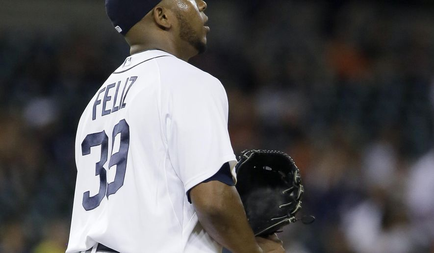Detroit Tigers pitcher Neftali Feliz walks back to the mound after giving up a grand slam to Seattle Mariners' Franklin Gutierrez during the eighth inning of a baseball game Tuesday, July 21, 2015 in Detroit. The Mariners defeated the Tigers 11-9. (AP Photo/Duane Burleson)