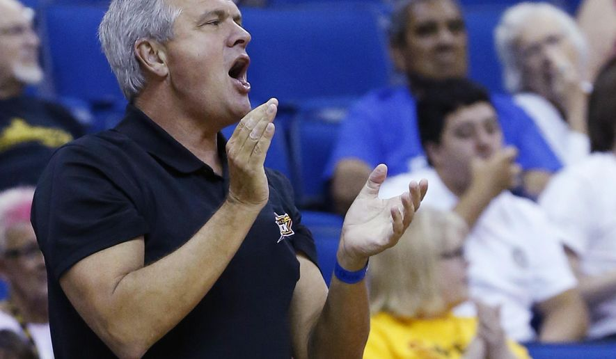 Stuart Price, one of the minority owners of the Tulsa Shock, cheers during a WNBA basketball game between the Shock and the Washington Mystics in Tulsa, Okla., Tuesday, July 21, 2015. Price filed a lawsuit against majority owner  Bill Cameron in Tulsa County District Court in hopes that the team will be forced to stay, after Cameron announced plans to move the franchise to the Dallas-Fort Worth market as early as next season. (AP Photo/Sue Ogrocki)