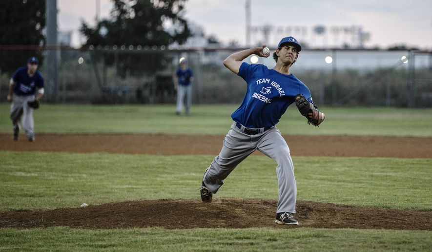 In this Monday, July 20, 2015 photo, Israel baseball team pitcher Dean Kremer pitches during training near the city of Petah Tikva, Israel. The 6-foot-2 Kremer is the golden boy of Israeli baseball, the first citizen to be selected in the major league draft and the country's greatest hope of lifting the sport from its decades-long second-class status.  (AP Photo/Tsafrir Abayov)
