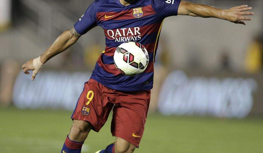 FC Barcelona's Luis Suarez controls the ball during the first half of an International Champions Cup soccer match against the Los Angeles Galaxy, Tuesday, July 21, 2015, in Pasadena, Calif. (AP Photo/Jae C. Hong)