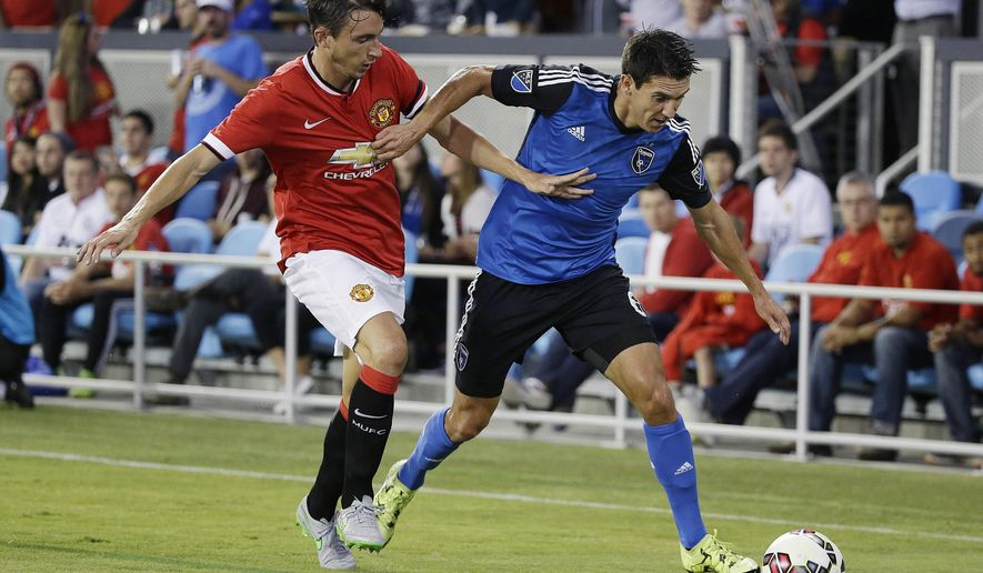 Manchester United defender Matteo Darmian, left, and San Jose Earthquakes midfielder Shea Salinas race for the ball during the first half of an International Champions Cup soccer match Tuesday, July 21, 2015, in San Jose, Calif. (AP Photo/Eric Risberg)
