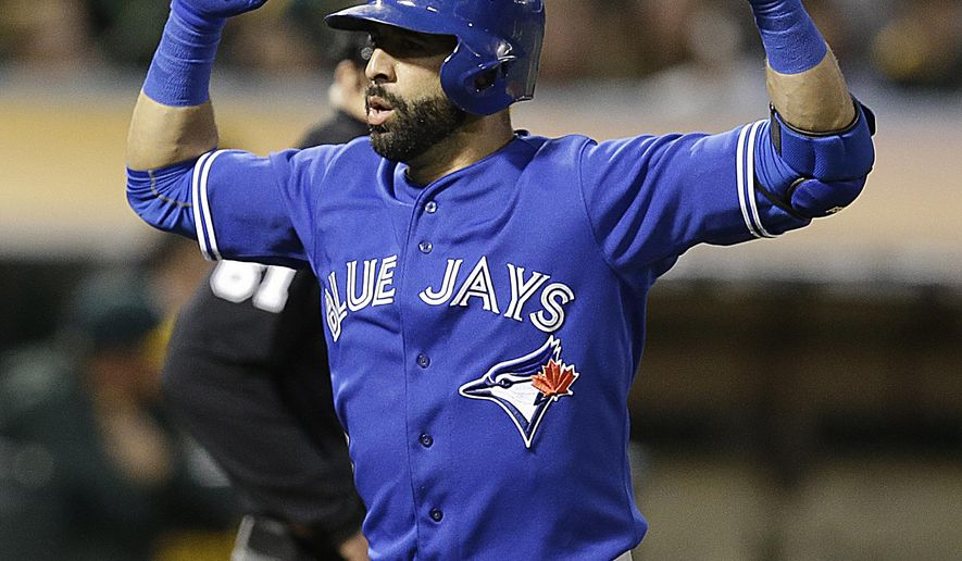 Toronto Blue Jays' Jose Bautista celebrates after hitting a home run off Oakland Athletics' Kendall Graveman during the sixth inning of a baseball game Tuesday, July 21, 2015, in Oakland, Calif. (AP Photo/Ben Margot)
