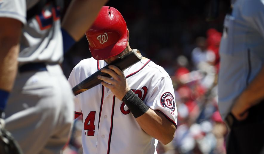 Washington Nationals right fielder Bryce Harper (34) kisses his bat as he prepares to bat during a baseball game against the New York Mets at Nationals Park, Wednesday, July 22, 2015, in Washington. (AP Photo/Alex Brandon)