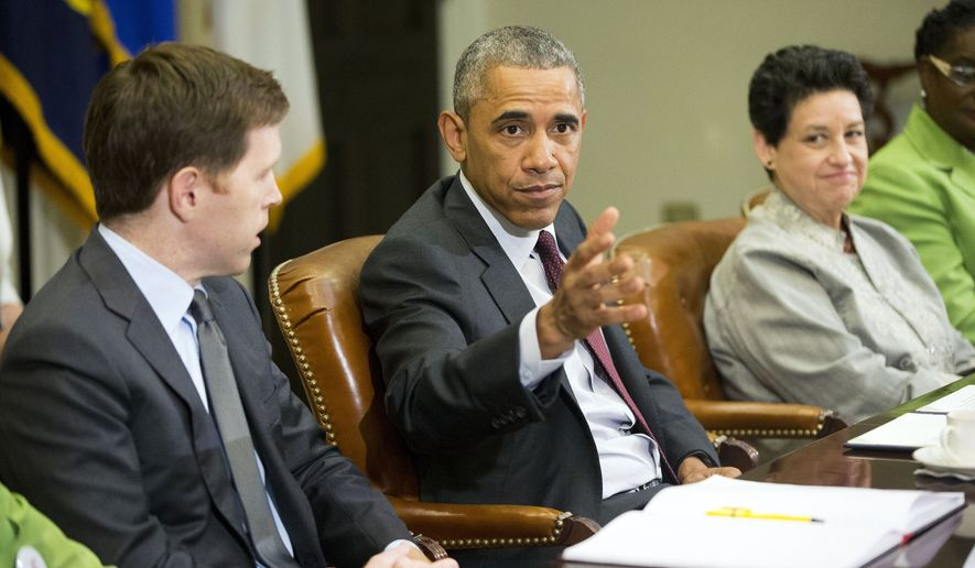 President Obama (center), with Paul Sullivan (left), vice president of international business development at Acrow Bridge, and Susan Jaime, CEO Ferra Coffee International, gestures during his meeting with small-business owners to discuss the importance of the reauthorization of the Export-Import Bank in the Roosevelt Room of the White House on July 22, 2015. (Associated Press)