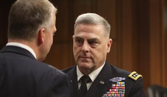 Gen. Mark Milley talks with Sen. Dan Sullivan, R-AK, after Milley's confirmation hearing at the Senate Armed Services Committee on July 21, 2015 on Capitol Hill in Washington.  Milley responded to questions about the deaths of four Marines and a sailor who were killed Thursday in Chattanooga, Tennessee.   (AP Photo/Lauren Victoria Burke) **FILE**