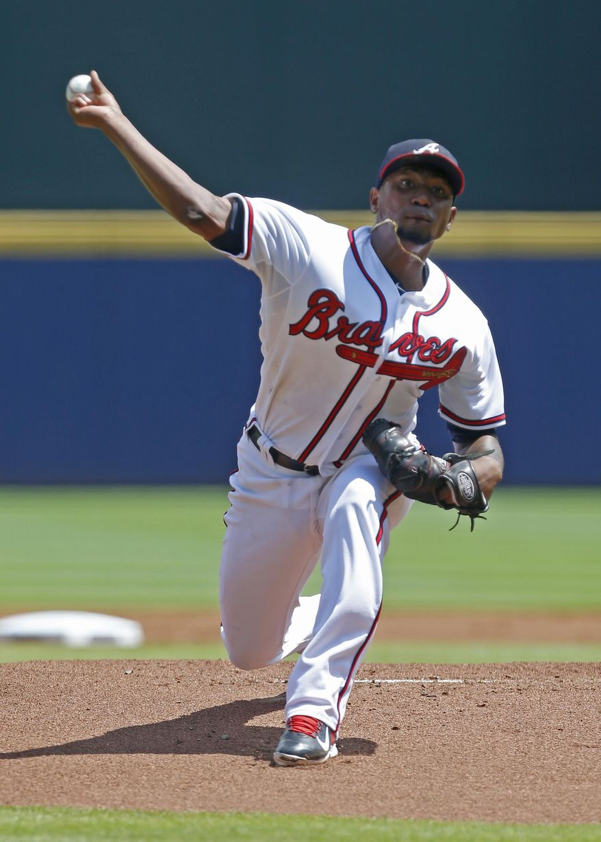 Atlanta Braves starting pitcher Julio Teheran (49) pitches against the Los Angeles Dodgers during the first inning of a baseball game, Wednesday, July 22, 2015, in Atlanta. (AP Photo/Butch Dill)