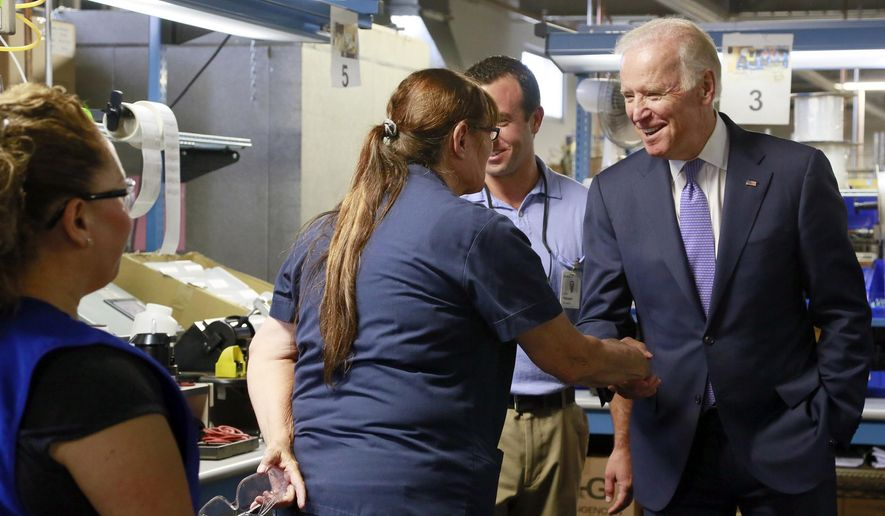Vice President Joe Biden, right, greets worker Pamela Mesolella, left, who assembles soap dispensers, during a visit at the Bobrick Washroom Equipment Factory in Los Angeles, Wednesday, July 22, 2015.  Mesolella said she had worked at the company for 21 years. The business has been in LA for more than 100 years, and its CEO backed the recent city ordinance that raises the minimum wage to $15 an hour over several years. Biden said the federal minimum wage, currently $7.25 an hour, should grow to at least $12. He says that would raise the standard of living for 35 million people. (AP Photo/Nick Ut)