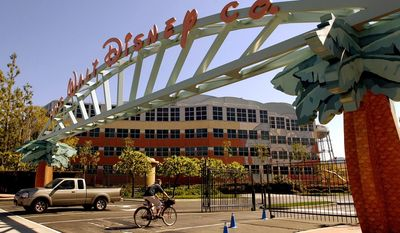 FILE - In this Feb. 11, 2004, file photo, shows the entrance to the Walt Disney Corp. office and studio complex in Burbank, Calif. The European Union announced Thursday, July 23, 2015, that it has opened an antitrust case against six major U.S. movie studios, including Disney,  for what it sees as a restriction of trade within the 28-nation bloc because consumers outside Britain and Ireland are prevented from tapping into their products through Sky UK. The other studios include NBCUniversal, Paramount Pictures, Sony, Twentieth Century Fox and Warner Bros. (AP Photo/Reed Saxon, File)