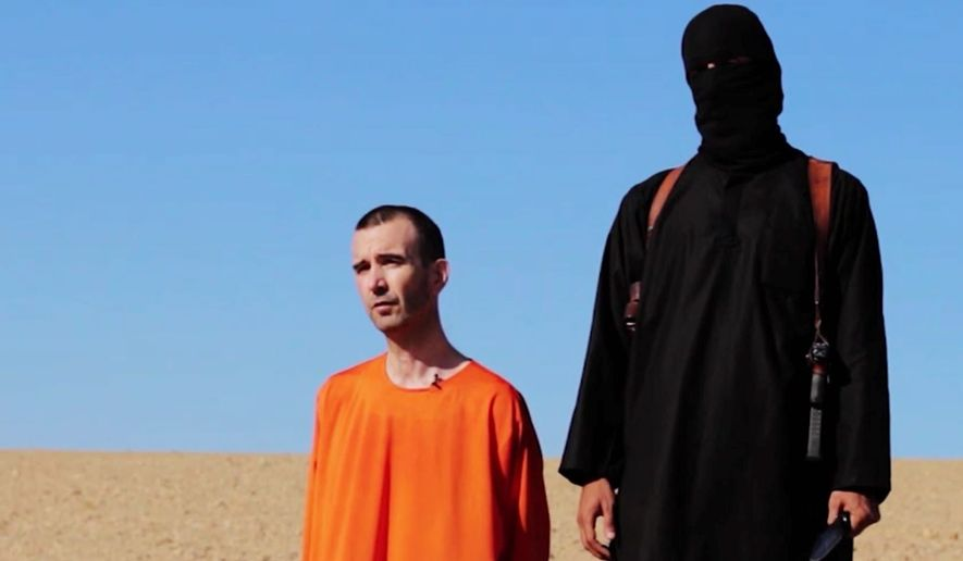Islamic State police enforce the group's strict interpretation of Shariah law. Use of brutality such as the grisly death of Briton David Haines subjugates people to authoritarian order. (Associated Press) ** FILE **